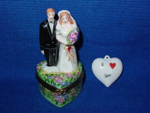 BRIDE & GROOM ON FLOWERED BASE
